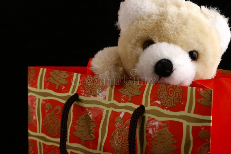 Bear in christmas bag royalty free stock images