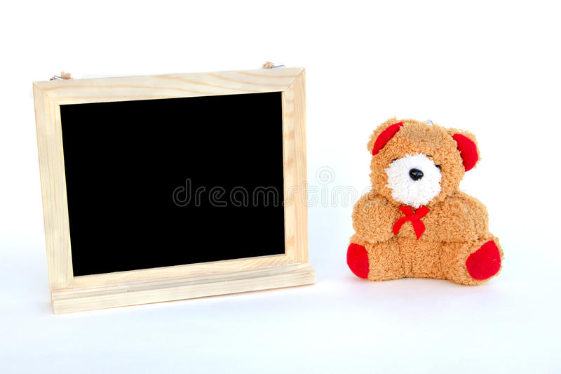 Bear doll and frame blackboard on white background. Bear doll and wood frame blackboard on white background royalty free stock photos