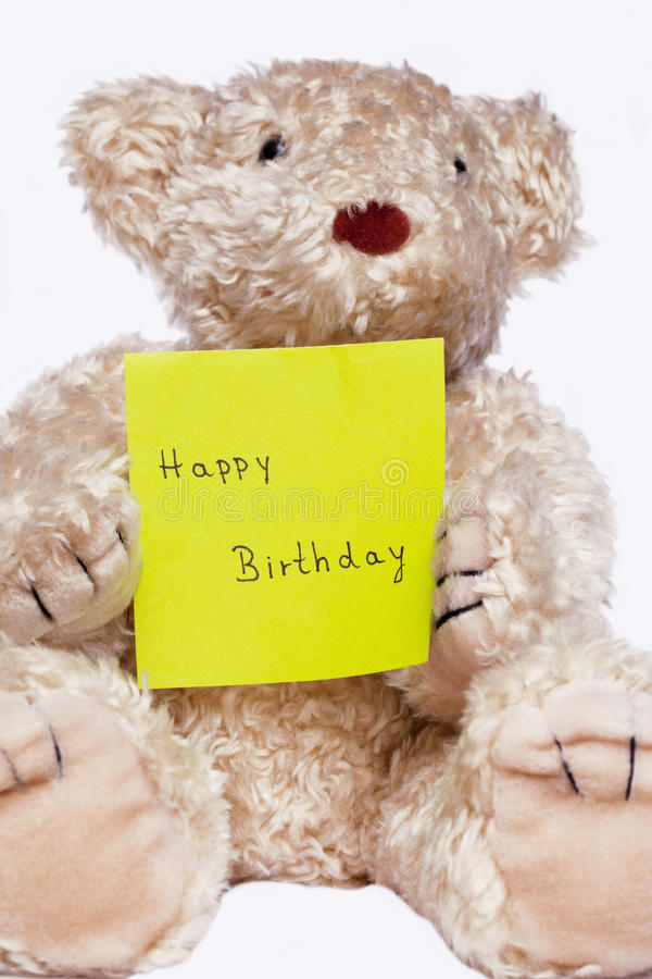 Bear Happy Birthday. Bear holding wishes Happy Birthday royalty free stock image