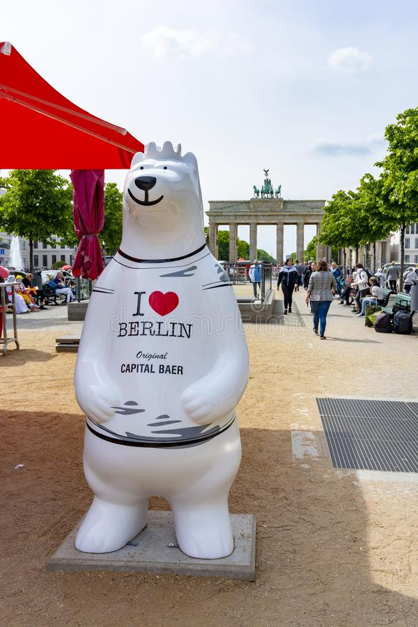 Bear with inscription `I love Berlin` and Brandenburg gate at background, Berlin, Germany stock images