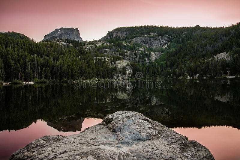 Bear Lake sunset Colorado Rocky Mountains. Bear Lake sunset Colorado Rocky Mountains with orange / pink sunset / sunrise reflected in calm lake water royalty free stock images