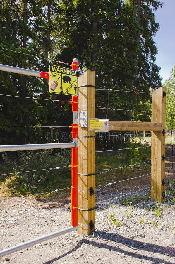Bear-resistant electric fence and gate royalty free stock image
