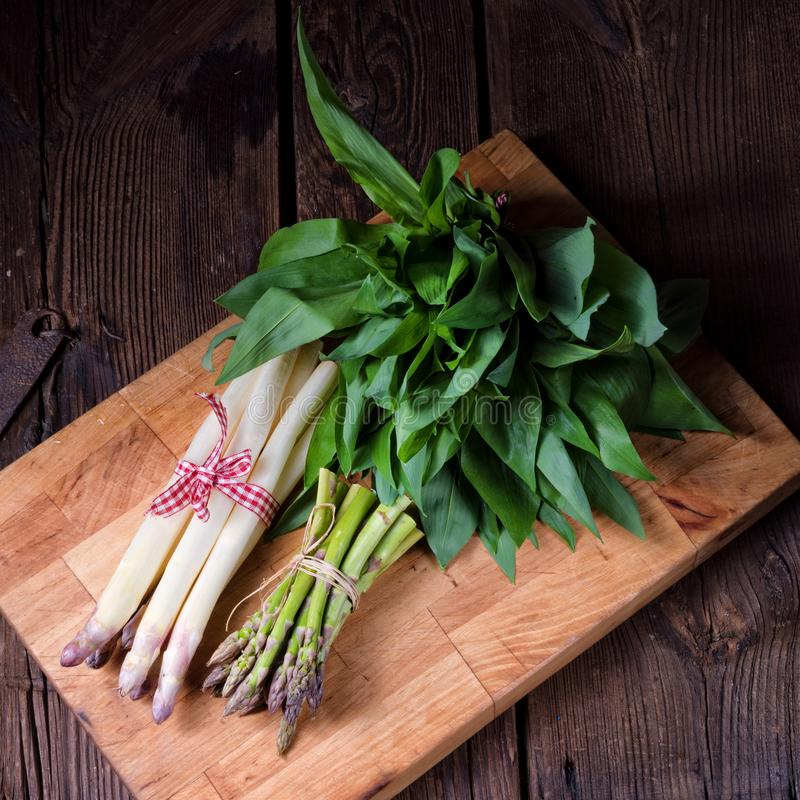 Bear`s garlic with white and green asparagus. A Bear`s garlic with white and green asparagus stock photo