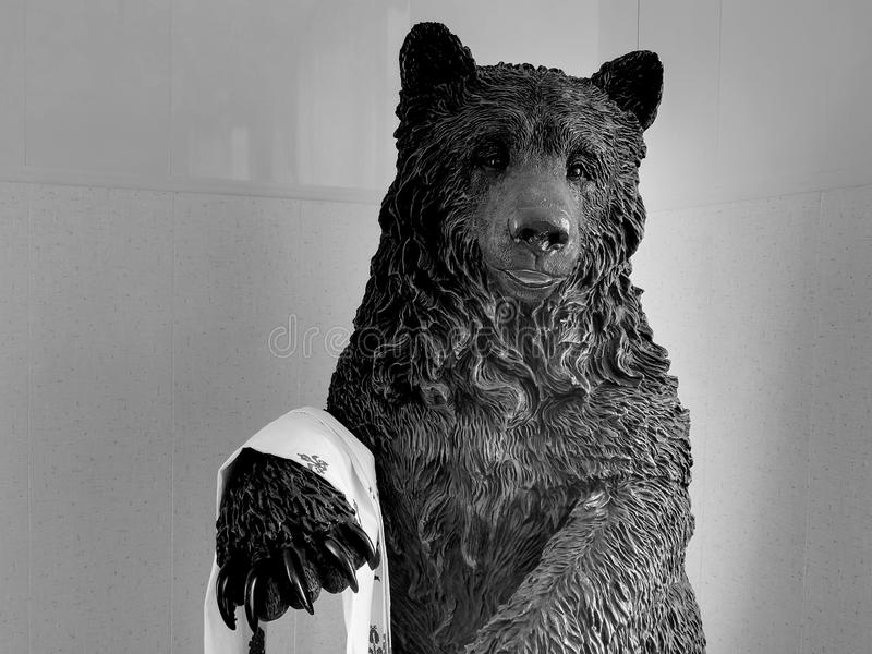 Bear statue on black and white image. Closeup royalty free stock image