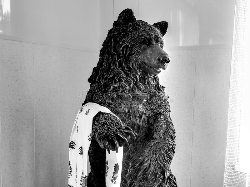 Bear statue on black and white image. Closeup stock photography