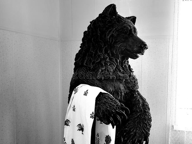 Bear statue on black and white image. Closeup stock photos