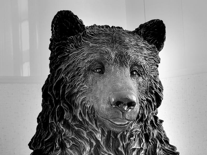 Bear statue on black and white image. Closeup stock images