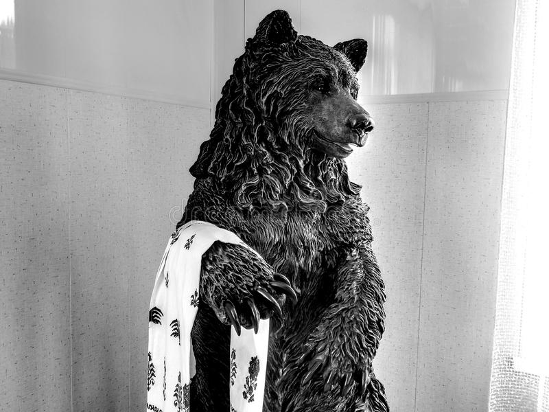 Bear statue on black and white image. Closeup royalty free stock images