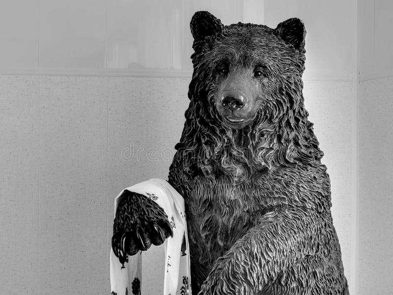 Bear statue on black and white image. Closeup royalty free stock photo