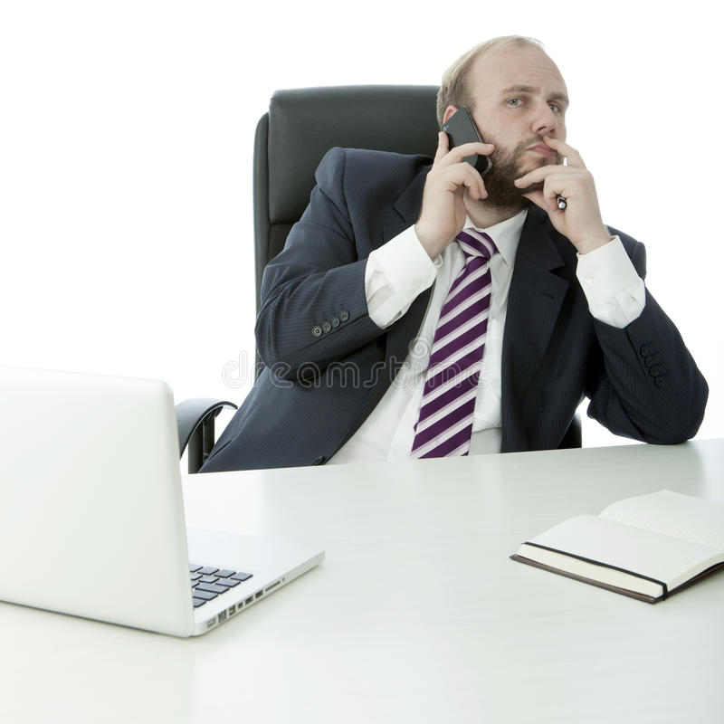 Beard business man on desk with cell phone