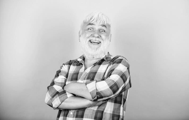 Beard and facial hair care. Barbershop hairdresser haircut. Grey hair. Elderly people. Bearded man with white hair wear stock image