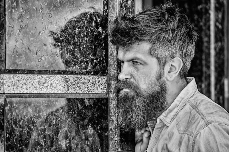 Beard grooming. Beard care. Masculinity and manliness. Man attractive bearded hipster posing outdoors. Confident posture royalty free stock images