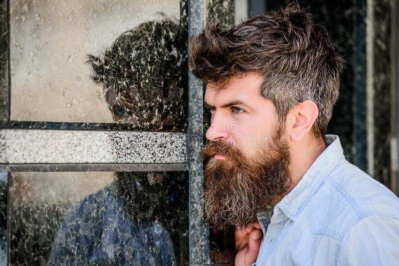 Beard grooming. Beard care. Masculinity and manliness. Man attractive bearded hipster posing outdoors. Confident posture royalty free stock image