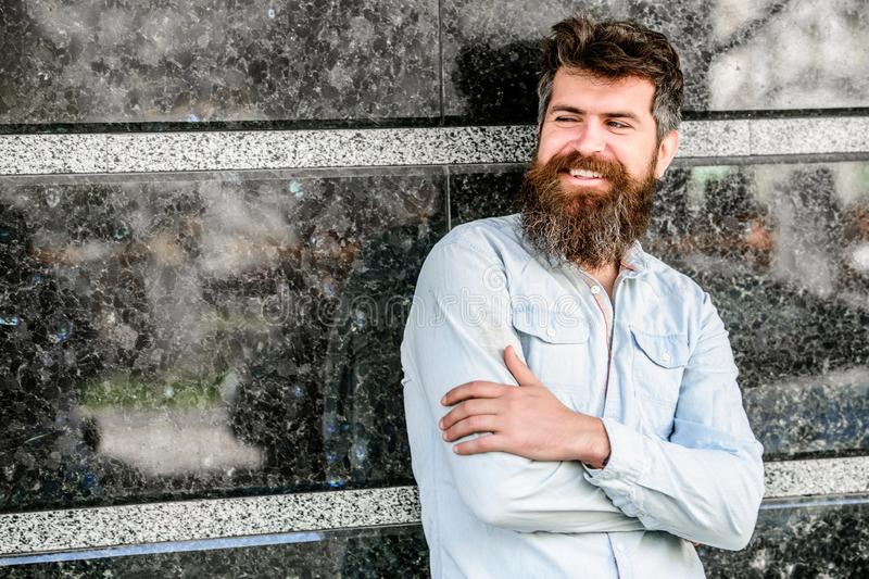 Beard grooming. Guy masculine appearance with long beard. Barber concept. Beard care. Man attractive bearded hipster royalty free stock photography