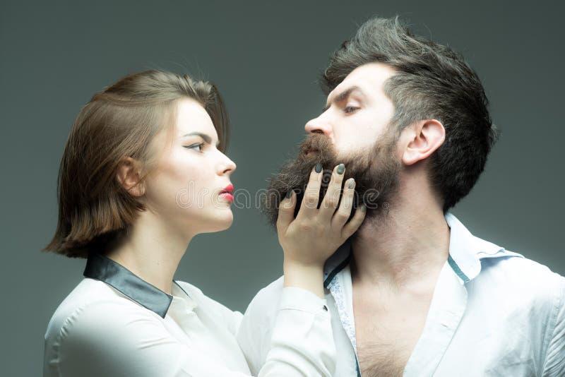 Beard grooming has never been so easy. Girl barber enjoy brutal bearded hipsters style. How grow great beard. Barber. Expert grooming tips. Beard care tricks stock image