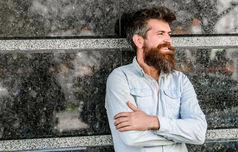 Beard grooming. Man attractive bearded hipster posing outdoors. Masculinity and manliness. Confident posture of handsome. Man. Guy masculine appearance with royalty free stock image