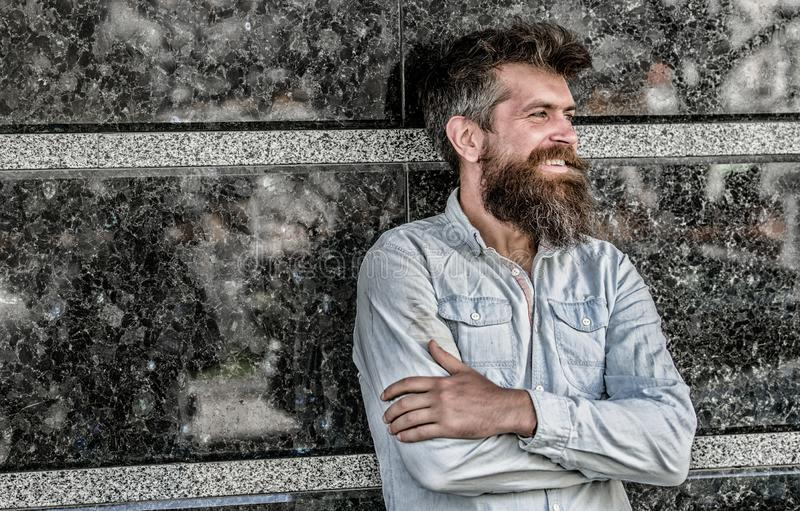 Beard grooming. Man attractive bearded hipster posing outdoors. Masculinity and manliness. Confident posture of handsome. Man. Guy masculine appearance with stock photo