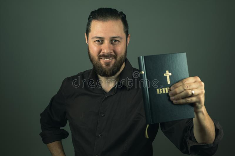 Beard man showing you a bible. The right path in life is through God royalty free stock photography