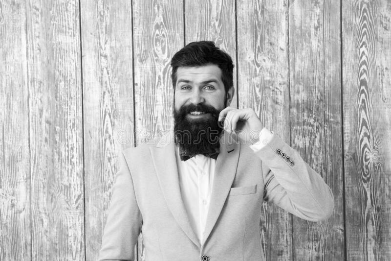 Beard and mustache. Barber shop concept. Guy well groomed handsome bearded hipster wear tuxedo. Gentleman style barber royalty free stock photos