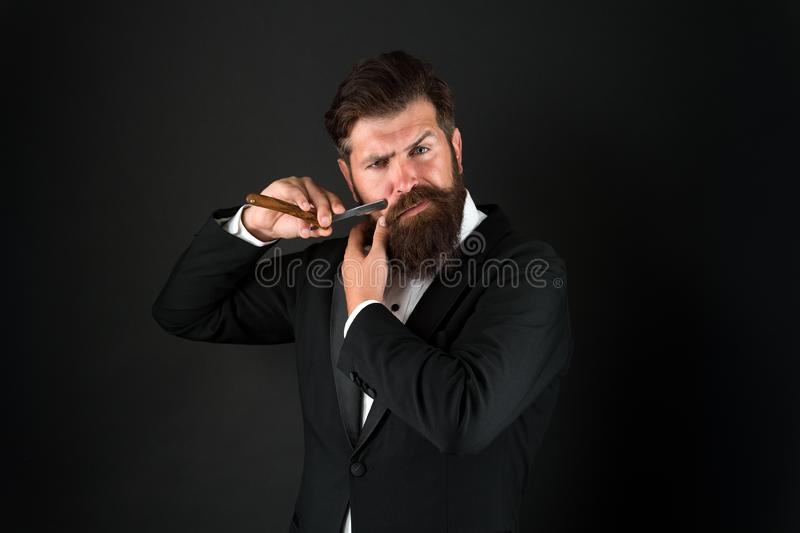 Beard is over. Brutal businessman shave with razor. Bearded man with classic shave. Shave barbershop. Shave and haircut stock images