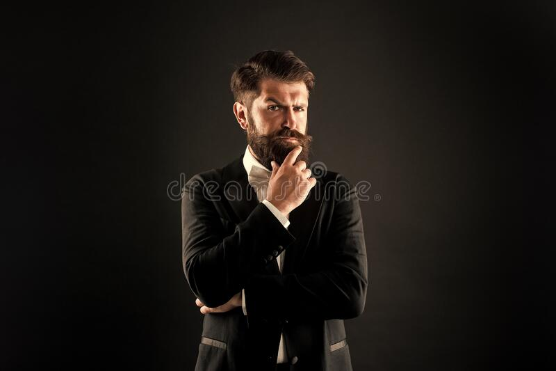 The beard trend will never truly be gone. Serious groom touch beard. Unshaven hipster with textured beard hair. Bearded stock photos