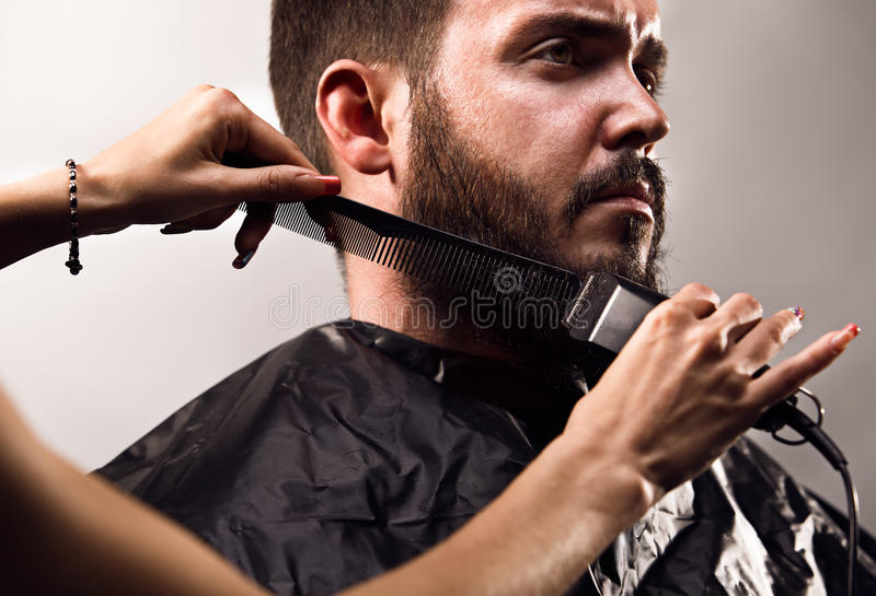 Beard trimming stock image