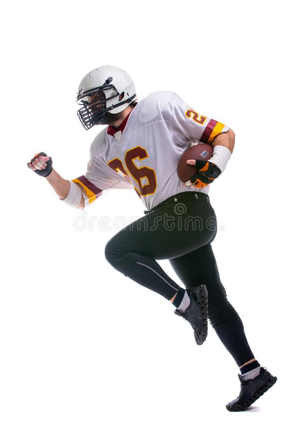 Bearded American football player in ation. Bearded American football player in white uniform, in action, isolated on white background stock photography