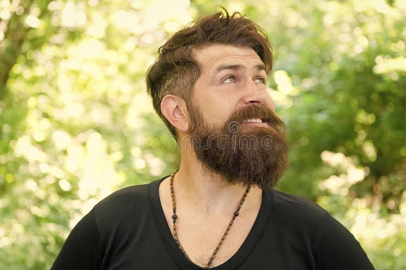 Bearded and beardy. Bearded man on natural environment. Bearded hipster in casual style on summer outdoor. Brutal stock photos