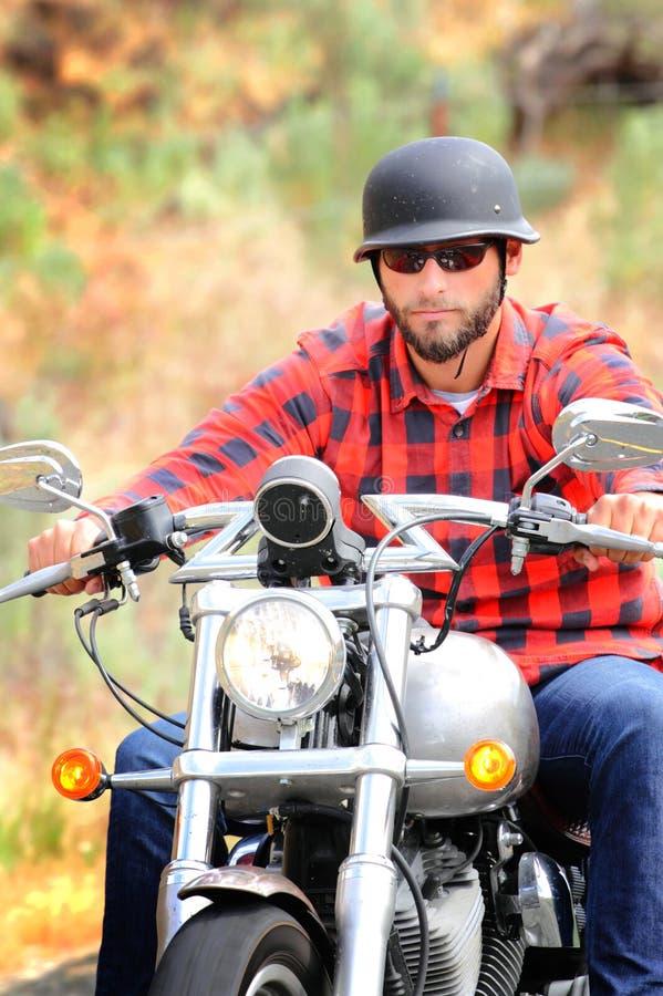Bearded Biker with Helmet stock photos