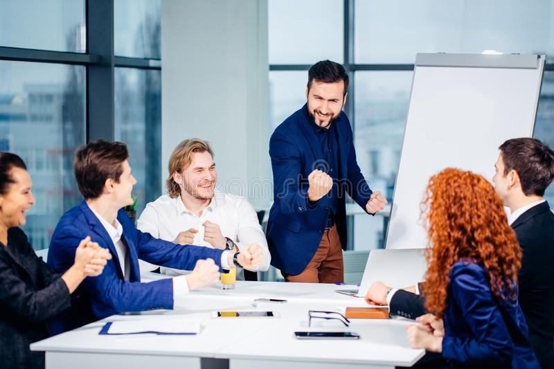 Boss leader coaching in office. On job training. Business and Education concept. Bearded boss leader coaching and teaching in modern office. On job training stock photo