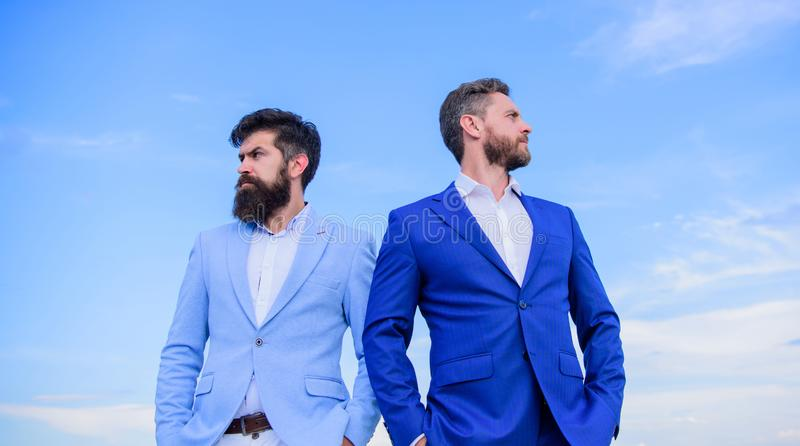Bearded business people posing confidently. Perfect in every detail. Business men stand blue sky background. Business. People concept. Well groomed appearance stock images