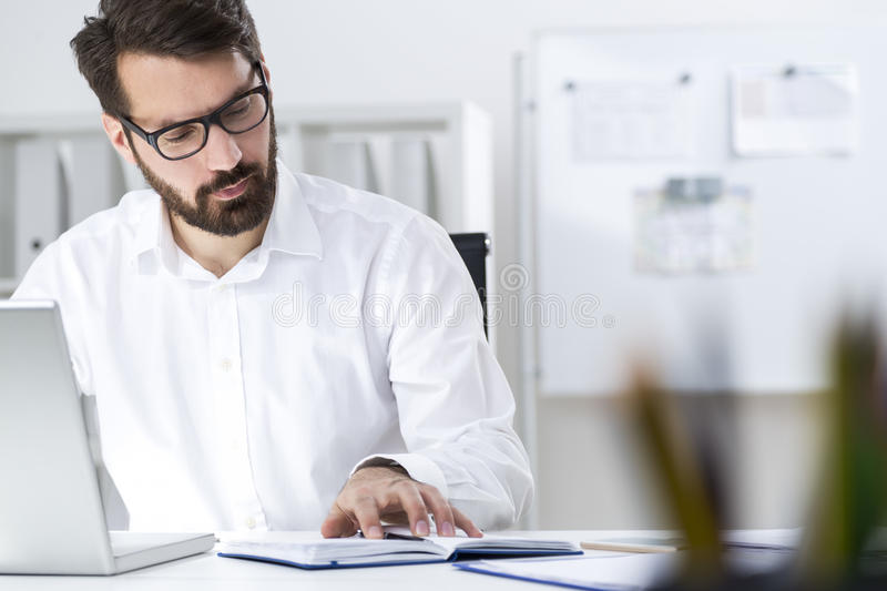 Download Bearded Businessman With His Notebook Stock Photo - Image: 83722734