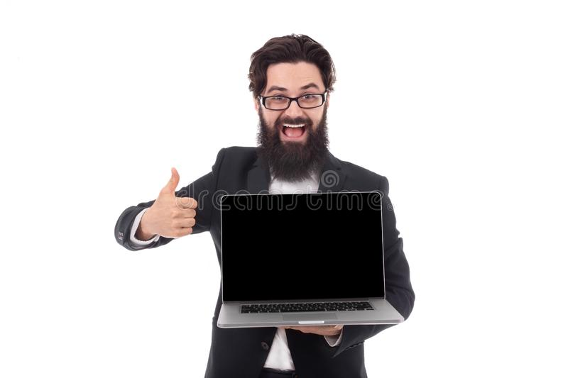 Bearded businessman with laptop royalty free stock photo