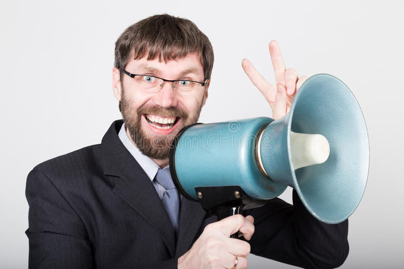 Bearded businessman yelling through bullhorn. Public Relations. man expresses various emotions. photos of young. Businessman wearing a suit and tie royalty free stock image