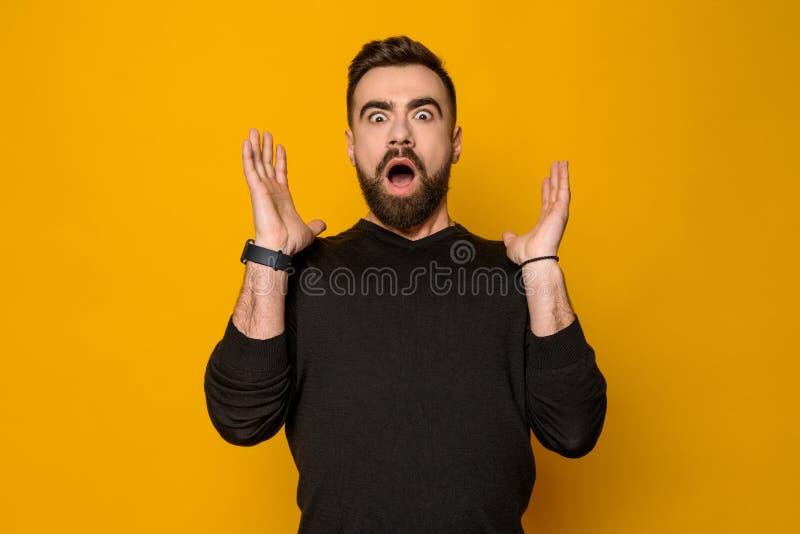 Bearded confident man expresses amazement royalty free stock image
