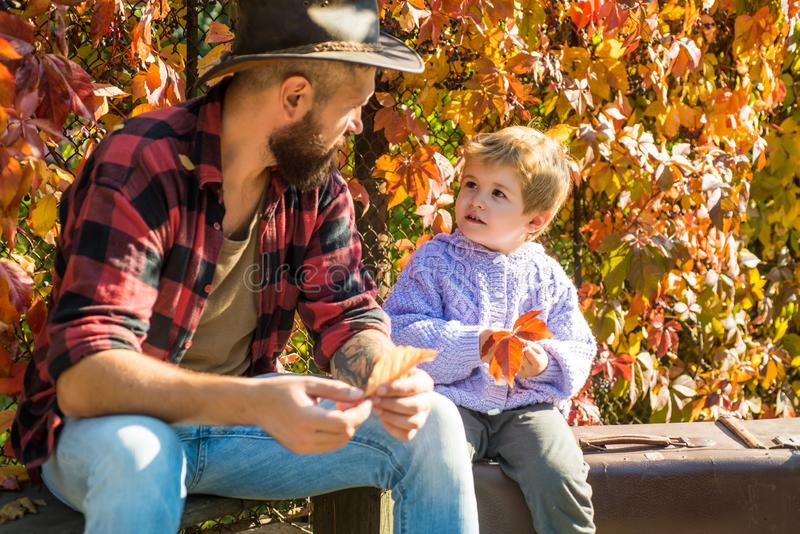 Bearded dad telling son about travelling. Traveler with lot experience. Fatherhood and upbringing. Family time stock image