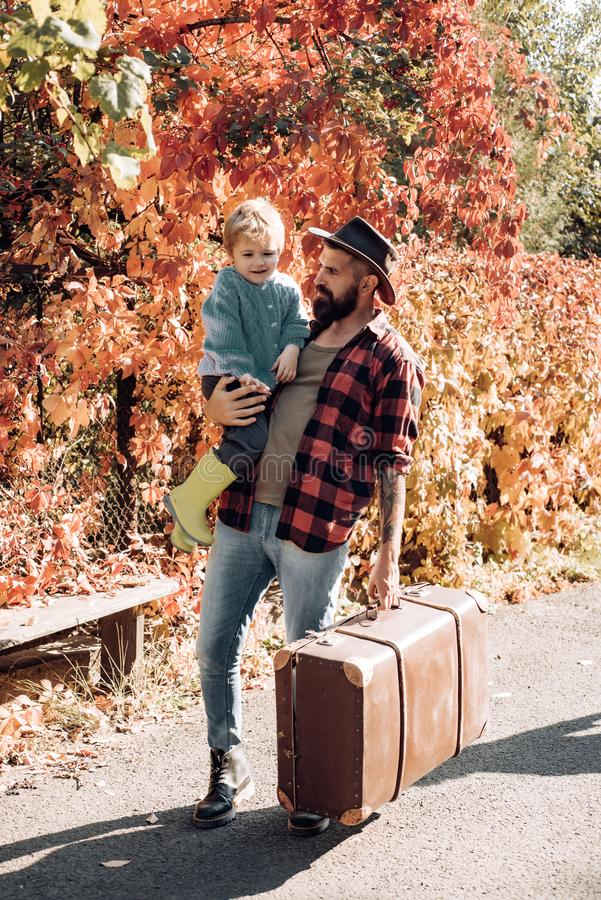 Bearded dad telling son about travelling. Traveler with lot experience. Spirit of adventurism. Family time. Adventure royalty free stock photo