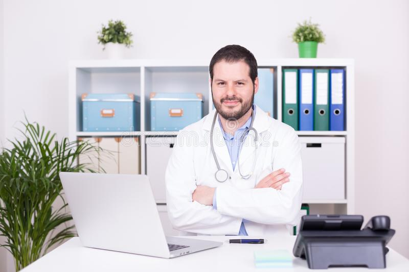 Bearded doctor working at his office. Business and medical concept royalty free stock photos