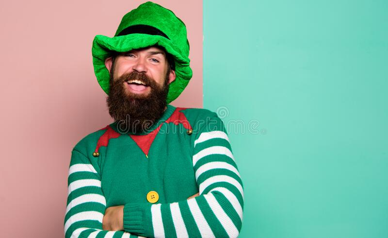 Bearded elf. Winter carnival. St Patricks day. Hipster with beard wearing green costume for party. Cheerful man. Celebrate holiday. Christmas elf. Elf concept royalty free stock image