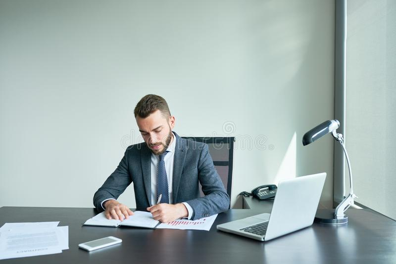Bearded Entrepreneur Wrapped up in Work royalty free stock images
