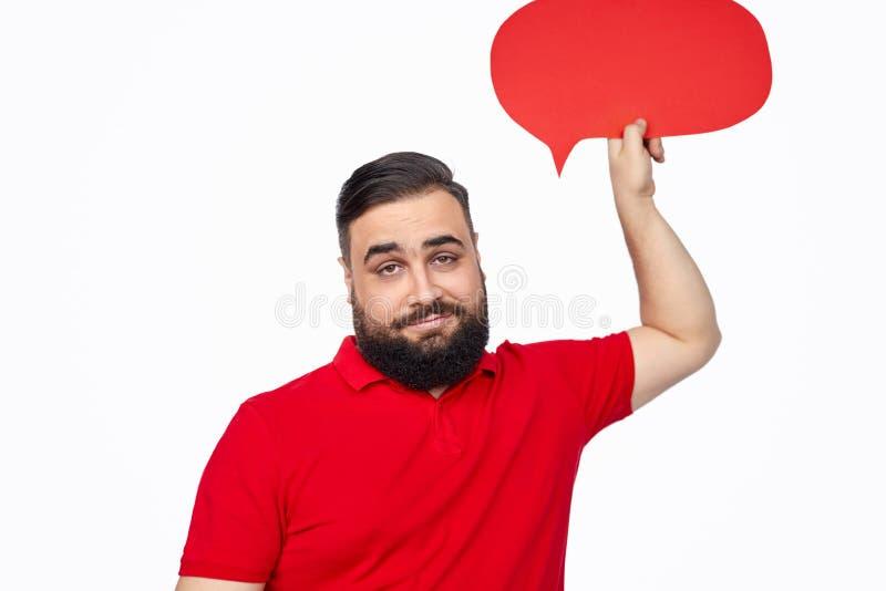 Bearded ethnic guy with speech bubble stock photo