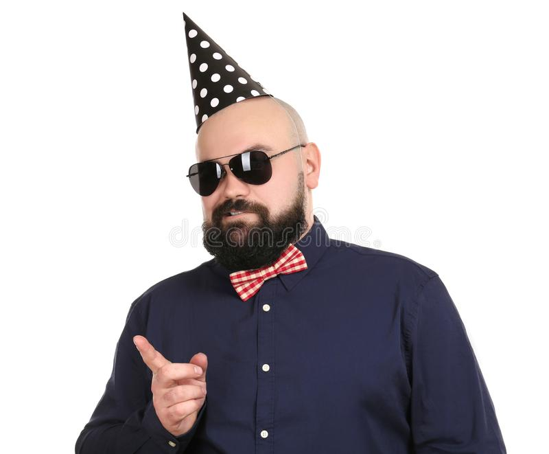 Bearded fat man with party hat on background royalty free stock photo