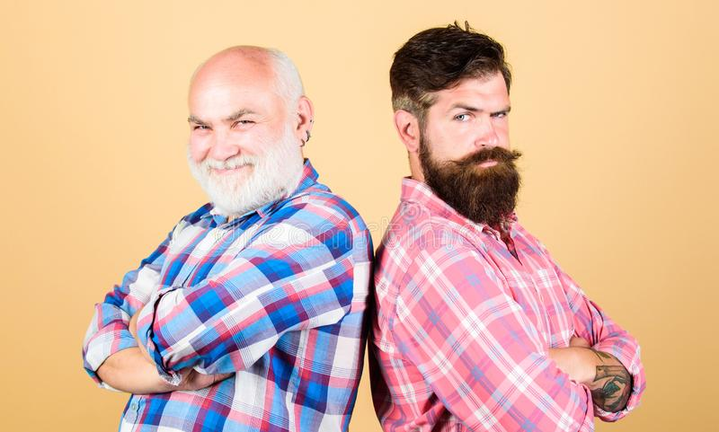 Bearded friends. Family team. Brutal guys with long beard. Barber well groomed handsome bearded man. Father and son stock photos