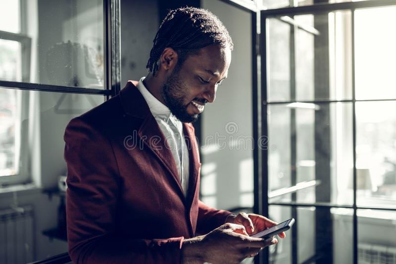 Bearded handsome businessman typing message for his wife royalty free stock photo