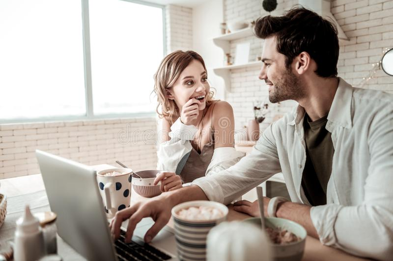 Bearded handsome man and his cute long-haired wife feeling pleased stock photography