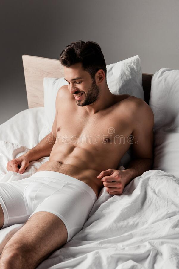 Free Bearded Handsome Sexy Man Lying On Royalty Free Stock Photos - 177336858