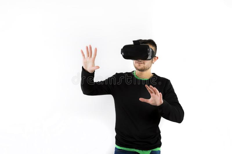 Bearded happy young nice and modern with vr glasses that enjoy virtual reality with simulator. Virtual reality with simulator over white background royalty free stock images