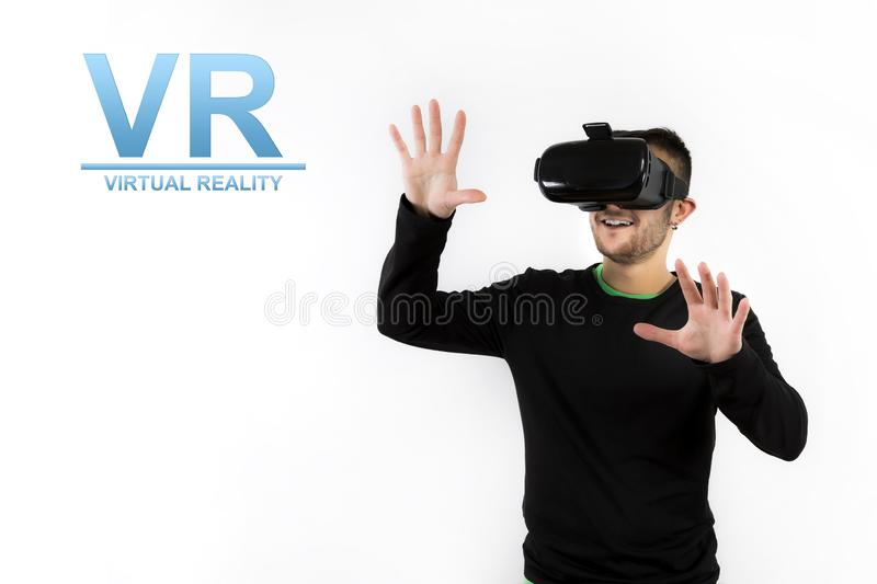 Bearded happy young nice and modern with vr glasses that enjoy virtual reality with simulator. Over white background with the text `VR Virtual reality stock photos