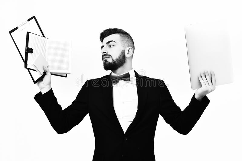 Bearded head manager in expensive outfit working with folders, organizer. Stickers and laptop, isolated on white background, copy space. Concept of busy day stock image