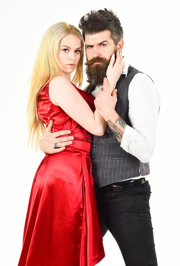 Bearded hipster and attractive lady dressed up for dancing contest. Couple in love, passionate dancers in elegant stock photos